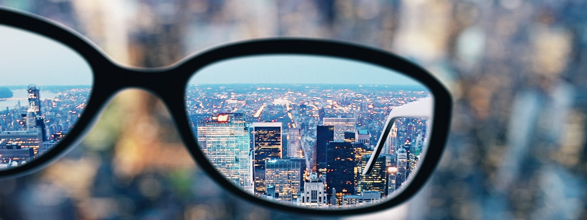 picture of glasses with reflection of skyline
