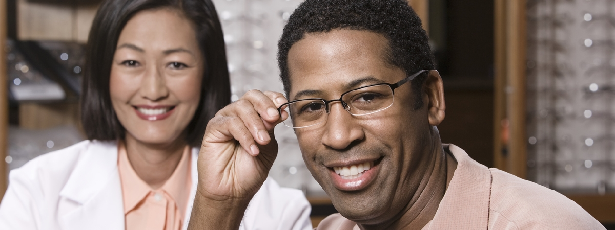 picture of optician helping patient