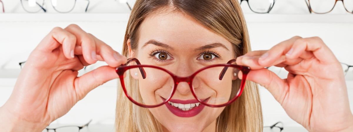 picture of woman trying on glasses